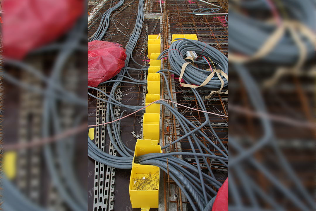 yellow ground form with pipes on a construction site
