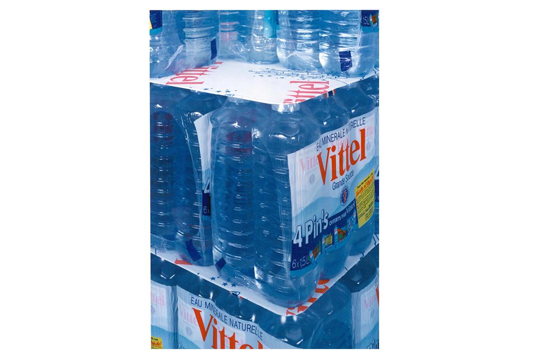 Plastic bottles stacked on layperpads